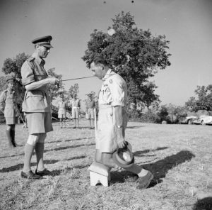 George_VI_knighting_General_Leese_Jul_1944
